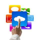 Hand pointing at cloud computing with colorful app icons Royalty Free Stock Photos