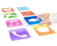 Hand pointing at cloud computing with colorful app icons Stock Photo