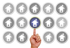 Hand pointing on color home icon Royalty Free Stock Image