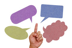 Hand pointing on color paper texture speech balloo Stock Photos