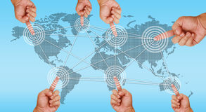 Hand pointing on continents Royalty Free Stock Photo