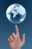 Hand pointing earth globe. Royalty Free Stock Photos