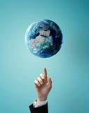 Hand pointing at earth Royalty Free Stock Photos
