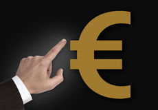 Hand pointing at Euro sign concept Royalty Free Stock Photos