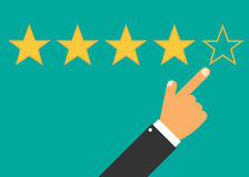 Hand with pointing finger pointing to rating stars. Stock Images