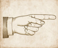 Hand with pointing finger. Woodcut Stock Photography