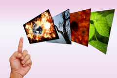 Hand pointing on global warming image Royalty Free Stock Photos