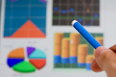 Hand pointing graph charts Stock Images