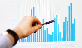Hand pointing on a graph data Stock Photos