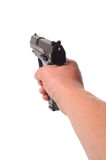 Hand Pointing a gun. Photograph of a hand pointing a pistol,shot in studio against a white background Royalty Free Stock Images