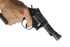 Hand pointing a gun at the target. On white background, selective focus on  gun Royalty Free Stock Images