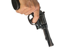 Hand pointing a gun at the target. On white background, selective focus on  gun Royalty Free Stock Photography