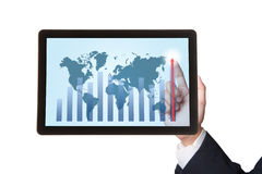 Hand pointing higher graph on tablet Royalty Free Stock Photo