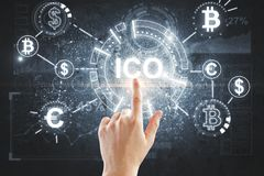 Hand pointing at ICO backdrop. Hand pointing at abstract ICO hologram on dark backdrop. Initial coin offering concept. 3D Rendering Stock Image