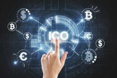 Hand pointing at ICO texture. Hand pointing at abstract ICO hologram on dark texture. Initial coin offering concept. 3D Rendering stock photo
