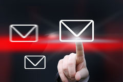 Hand pointing at icon. Hand pointing at mail icons against abstract background Royalty Free Stock Photography
