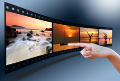 Hand pointing image in 3D film strip Stock Photos