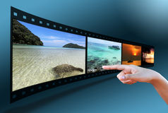 Hand pointing image in 3D film strip Stock Images