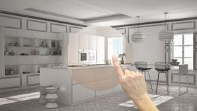 Hand pointing interior design project, home project detail, deciding on rooms furnishing or remodeling concept, modern kitchen in. Classic interior, island with stock photos