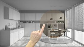 Hand pointing interior design project, home project detail, deciding on rooms furnishing or remodeling concept, modern kitchen wit stock photo