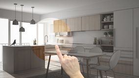Hand pointing interior design project, home project detail, deciding on rooms furnishing or remodeling concept, modern minimalisti royalty free stock image
