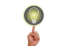 Hand pointing on lamp button Stock Images