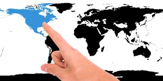 Hand pointing on map. Hand pointing on world map. North America highlighted royalty free stock image
