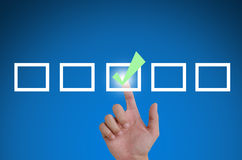Hand pointing a mark the check boxes. On a touch screen interface Stock Photos