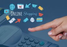 Hand pointing and Online shopping text with drawings graphics Stock Images