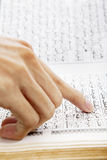 Hand pointing at paragraph of quran. Closeup of muslim man hand pointing at paragraph of quran. Shot during the month of ramadan royalty free stock photos