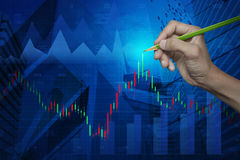 Hand pointing pencil on stock analysis graph over map and city, Stock Images