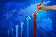Hand pointing pencil to red arrow head with financial chart and Royalty Free Stock Images