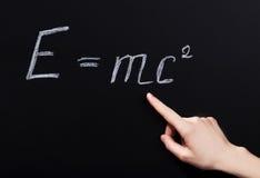 hand pointing on phisics formula. Stock Photos
