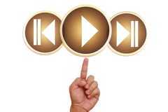 Hand pointing on play button Stock Photography