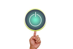 Hand pointing on power button Stock Image