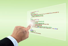 Hand pointing programming script Royalty Free Stock Photography