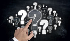 Hand pointing at question mark cloud concept Royalty Free Stock Photos