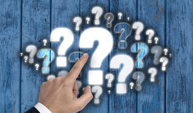 Hand pointing at question mark cloud concept Stock Image