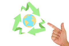 Hand pointing on recycle sign. Created with arrow origami paper texture style with the world inside Stock Photography