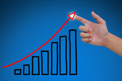Hand pointing showing graph. Business hand pointing showing graph Stock Photos