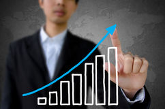 Hand pointing showing graph. Stock Photo