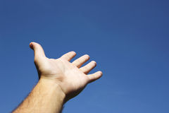 Hand pointing the sky. With differently directed fingers Royalty Free Stock Images