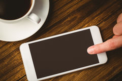 Hand pointing the smartphone Stock Photography