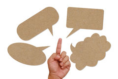 Hand pointing on speech balloon Royalty Free Stock Image