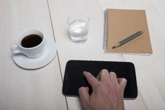 Hand pointing at a Tablet PC on the desk Royalty Free Stock Image