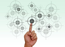 Hand pointing on target Stock Images