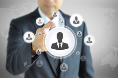 Hand pointing to businessman icon  - HR & recruitment concept. Hand pointing to businessman icon  - HR, recruitment and chosen concept Royalty Free Stock Photography