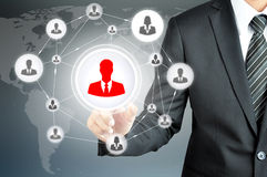 Hand pointing to businessman icon in the middle that linked with each other as network Royalty Free Stock Photography