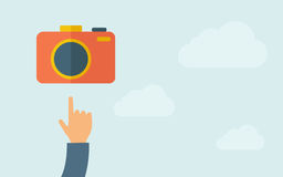 Hand pointing to a camera icon Royalty Free Stock Image