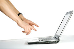 Hand pointing to the computer. Isolated over white background Stock Image